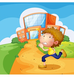 A boy running in front of the school vector image