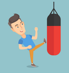 Man exercising with a punching bag vector