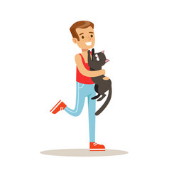 Smiling boy holding a black cat on his hands vector
