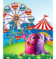 A hilltop with a carnival and monsters vector