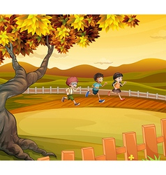 Three kids running along the field vector
