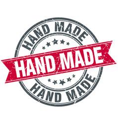 Hand made red round grunge vintage ribbon stamp vector