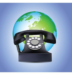 Old telephone and globe vector