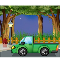A green car at the street vector image vector image