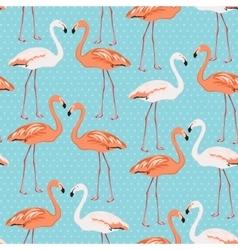 Flamingo couple seamless pattern on blue polka dot vector