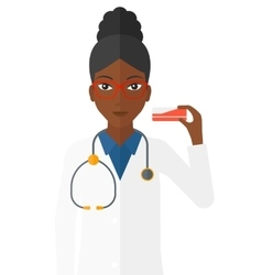 Pharmacist showing some medicine vector