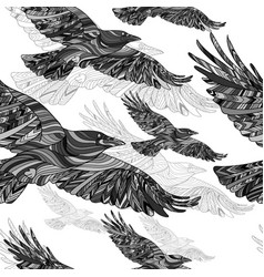 seamless pattern of hand-drawn crows with ethnic vector image