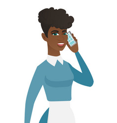 Young african cleaner talking on a mobile phone vector