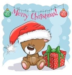 Teddy bear in a santa hat vector