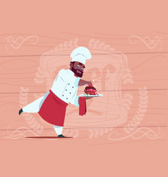 African american chef cook holding dessert dish vector