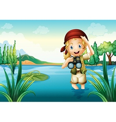 A girl scout at the lake vector image