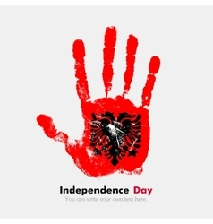 Handprint with the flag of albania in grunge style vector