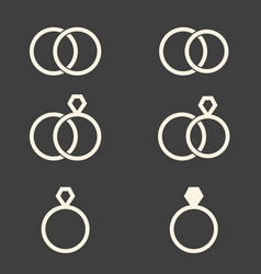 Set of engagement rings icons on dark grey vector