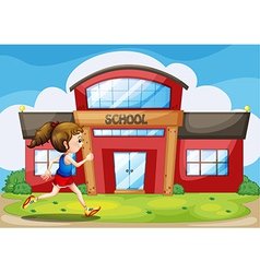 A girl in front of the school building vector image vector image
