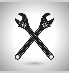 adjustable wrench crossed black icons vector image