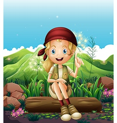 A smiling girl resting near the rocks vector