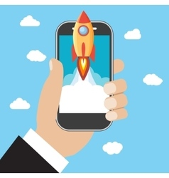 Hand holds smartphone with launch rocket vector image vector image