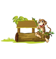 A monkey sitting with a wooden signboard vector