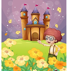 A boy pointing near the flowers in the hill with a vector image