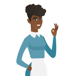 Young african-american cleaner showing ok sign vector