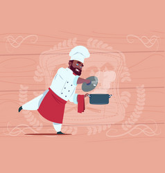 African american chef cook holding saucepan with vector