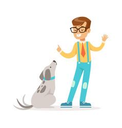 Cute boy wearing glasses teaching his dog vector
