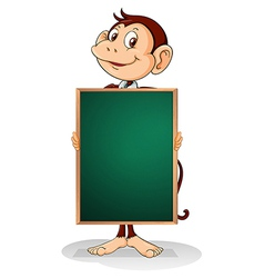 A male monkey holding an empty blackboard vector