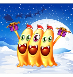 Three monsters celebrating christmas vector