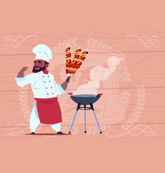 African american chef cook hold kebab smiling vector