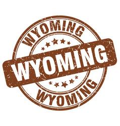 Wyoming brown grunge round vintage rubber stamp vector