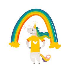 Happy unicorn character standing under big rainbow vector