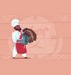 African american chef cook hold turkey smiling vector