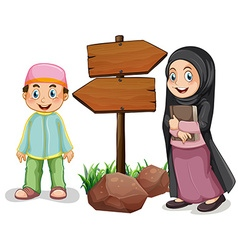 Two muslim kids and wooden signs vector