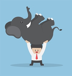 Businessman lifting an elephant vector