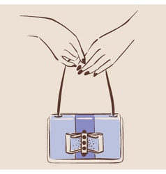 Woman hand holding a stylish bag vector