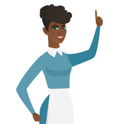 Young african cleaner pointing her forefinger up vector