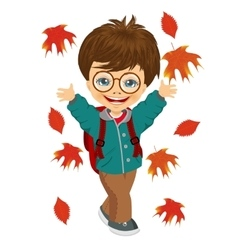 Little boy playing with autumn leaves vector