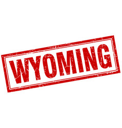 Wyoming red square grunge stamp on white vector
