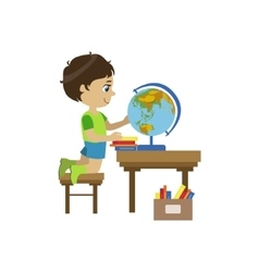 Little boy playing with globe vector