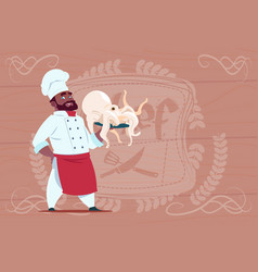 African american chef cook hold octopus smiling vector