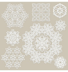 Highly detailed paper cut white snowflakes vector