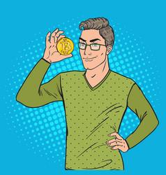 pop art smart man holding golden bitcoin vector image vector image
