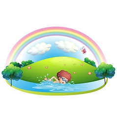A young man swimming near the hill with a rainbow vector image vector image