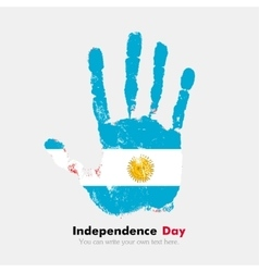 Handprint with the flag of argentina in grunge vector