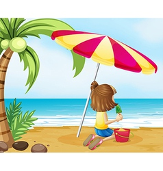 A young girl playing with the castle at the beach vector image vector image