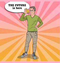 pop art smart businessman holding golden bitcoin vector image
