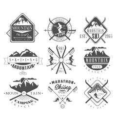 Vintage skiing labels and design elements set vector