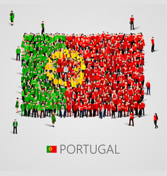 large group of people in the portugal flag shape vector image vector image