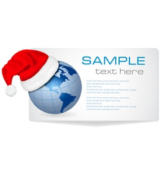 santa hat on a globe vector image vector image