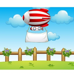 A stripe blimp carrying an empty banner vector image